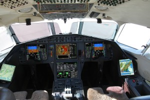 CMC Electronics Flight Bag shown in a Falcon 2000 cockpit
